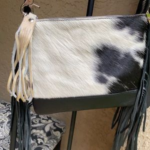 Leather cowhide crossbody bag . New.